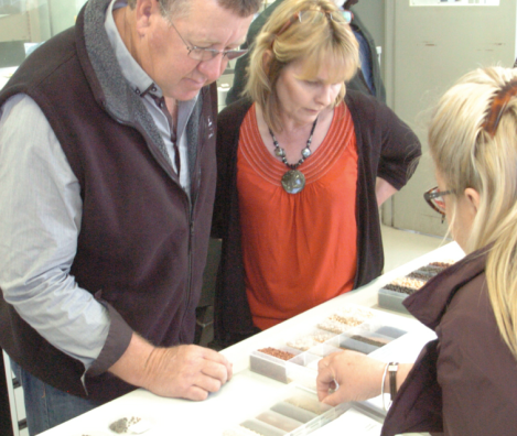 Credit: Econnect Communication.  Andrea and Mark inspect new grain varieties during a Climate Champion program workshop.